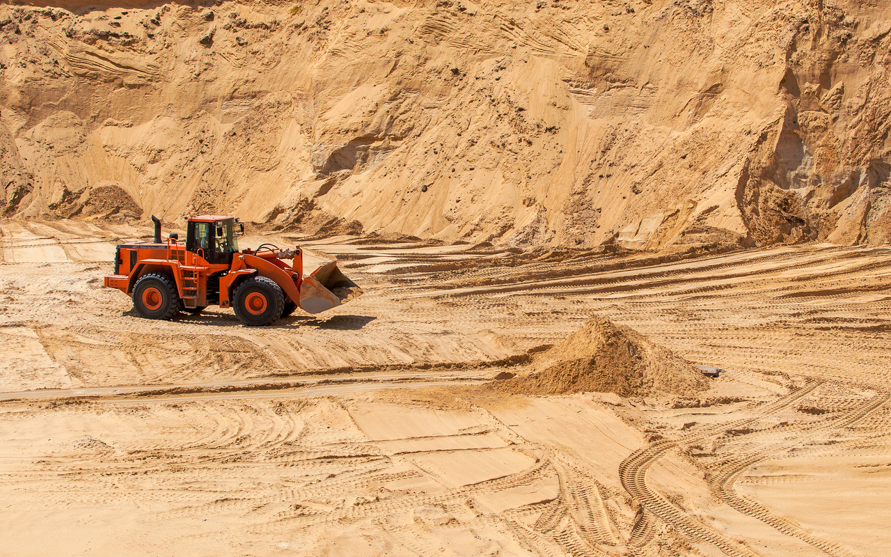 The excavator works in the sandy quarry, sand mining, sand pit